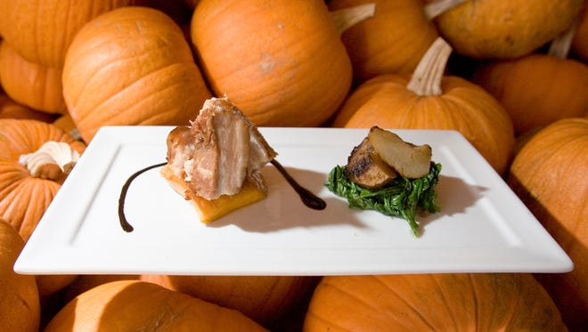 Chef James Porter creates roasted pork belly with pumpkin confit, caramelized pears, mustard greens and riesling gastrique.