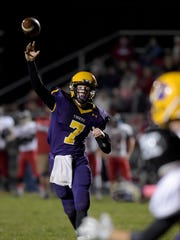 Hagerstown's Owen Golliher throws a pass against Knightstown during a football sectional game Friday, Oct. 28, 2016 in Hagerstown.