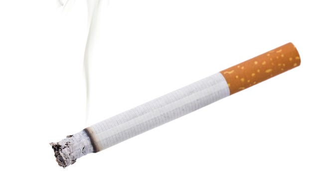 cigarette with a portion of smoke, isolated on white
