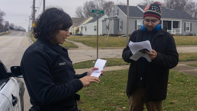 In this file photo, Maggie Semington, a patrol officer with the Galesburg Police Department, questions an election campaign volunteer because of a report in the area of a solicitor. Many area police officers go through the School of Law Enforcement and Justice Administration at Western Illinois University in Macomb. Director of that program Dr. Jill Joline Myers says education is the key for social change.