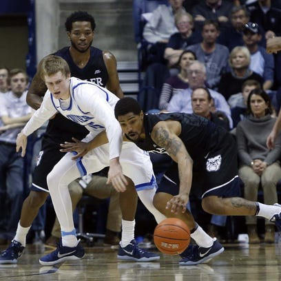 Xavier Musketeers guard J.P. Macura (55) has the ball
