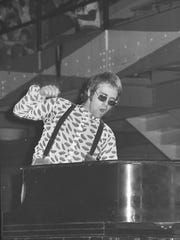 Elton John performs at Jenison Fieldhouse in East Lansing,