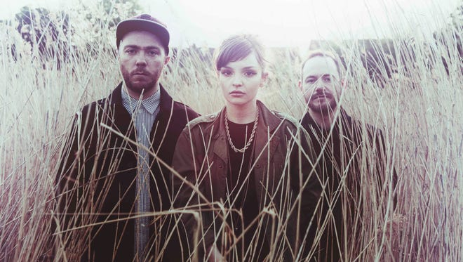 """From left, Martin Doherty, Lauren Mayberry and Iain Cook of CHVRCHES. Their debut album, """"The Bones of What You Believe,"""" is out Sept. 24."""