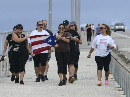 Supporters of Puerto Rico march over the Melbourne Causeway Saturday morning in a show of concern and solidarity for their loved ones affected by Hurricane Maria