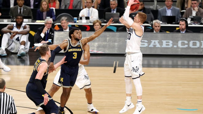 Villanova's Donte DiVincenzo knocks down one of his five 3-pointers in the Wildcats' national championship game win over Michigan on Monday night.