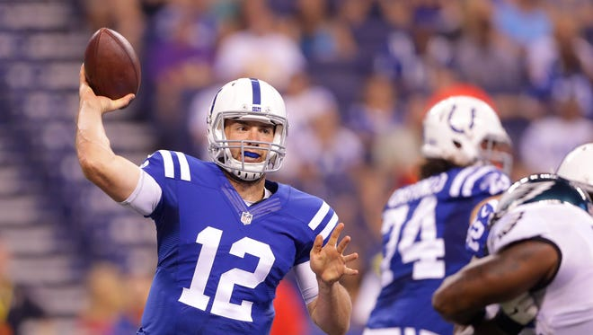 Indianapolis Colts quarterback Andrew Luck (12) throws during the first half of an NFL football game Saturday, Aug. 27, 2015, at Lucas Oil Stadium.