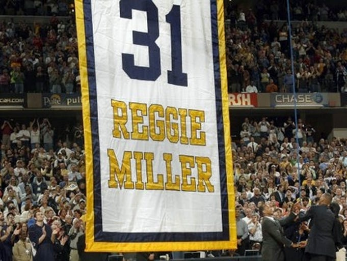 Reggie Miller and his family, right, raise his number