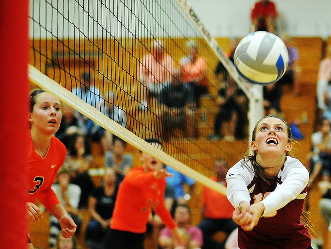 Roosevelt's Maia Gabrielson (16) bumps the ball during a match against Sioux City East on Tuesday, Sept. 2, 2014, at Roosevelt High School in Sioux Falls, S.D.