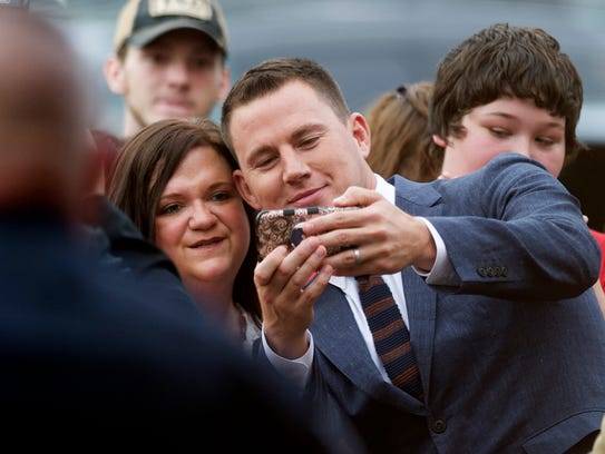 Channing Tatum takes a selfie with a fan during the