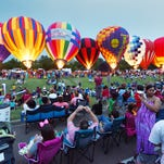 "Hot air ballons glow to the delight of the crowd gathered at the annual ""Celebrate America"" Balloon Glow at Northpark Mall in Ridgeland on Friday."