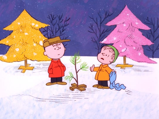 Charlie Browh and his friend, Linus, examine their tiny tree in 'A Charlie Brown Christmas.'