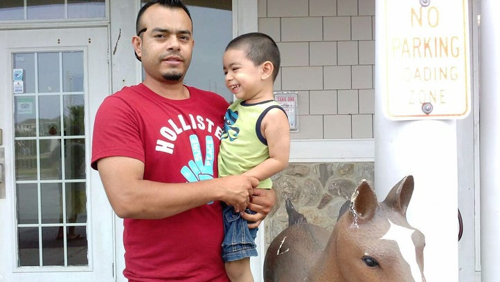 Angel Ortiz Paz holds Angel Jr., his 6-year-old-son.