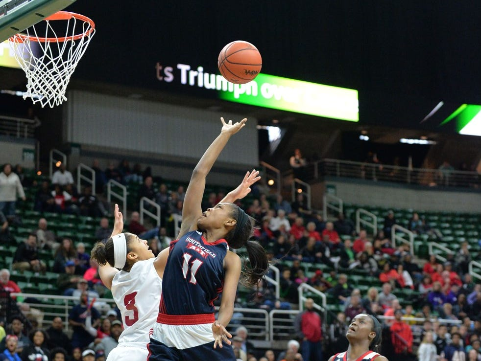 Southfield A&T junior D'Layna Holliman, right, battles for a loose ball against East Kentwood's Amari Brown in Friday's Class A semifinal at the Breslin Center. East Kentwood won, 55-51, and plays Flushing in Saturday's noon final.