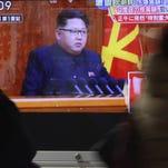 A TV screen in Tokyo shows North Korean leader Kim Jong Un on Jan. 6, 2016.