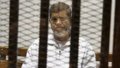 In this May 8, 2014, file photo, Egypt's ousted Islamist