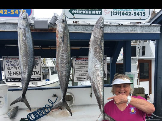 Marilyn Garazin, offshore fishing in the gulf aboard the Miss Louise with Captain Roger, at Rose Marina.