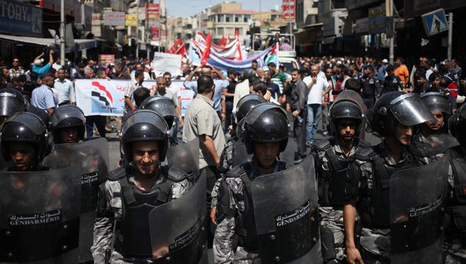 Jordanian anti-riot forces form a chain around a protest against a possible American military strike in Syria, in Amman, Jordan, on Friday.