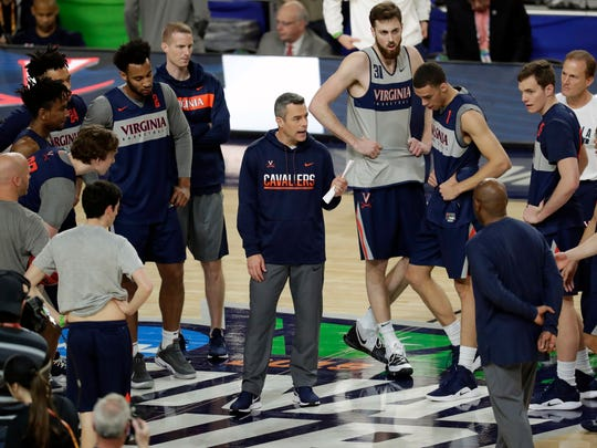 Virginia head coach Tony Bennett talks to his team during a practice session before the Final Four on Friday, April 5, 2019, in Minneapolis.