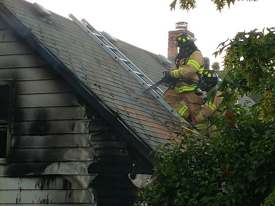 Firefighters work to extinguish a house fire in Dallas