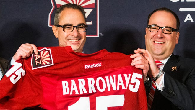 Arizona Coyotes new majority owner Andrew Barroway, left, receives jersey from co-owner, president and CEO Anthony LeBlanc.