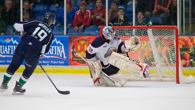 Saginaw goalie David Ovsjannikov foils Plymouth Whalers forward Cullen Mercer on a shorthanded breakaway during the third period.