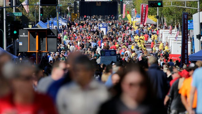 An early crowd fills College Avenue as Octoberfest takes place Saturday in Appleton.