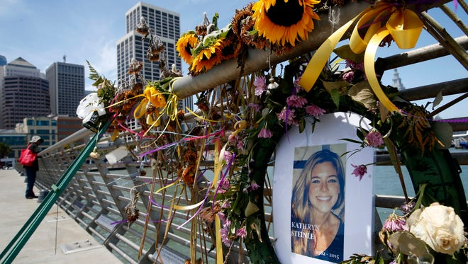 In this July 17, 2015 file photo, flowers and a portrait of Kate Steinle remain at a memorial site on Pier 14 in San Francisco. A jury recently found an undocumented immigrant not guilty in Steinle's death, a decision that reignited the debate over immigration policy.