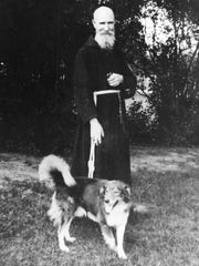 Father Solanus Casey is pictured with a dog in 1935.