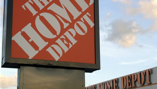 Home Depot stores in four Michigan counties fell victim to a shoplifting and gift-card scam that cost the stores $600,000 to $800,000.