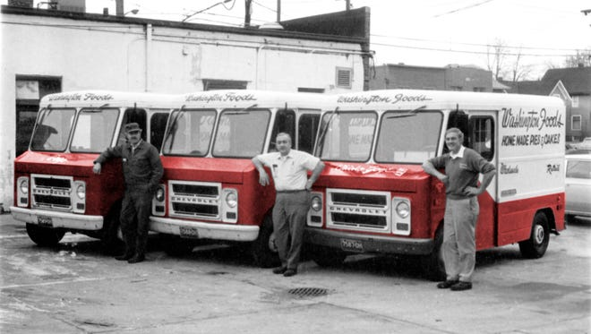 Christ, Carl, and Blagoy Pogoncheff  standing in front of the Washington Foods pie delivery trucks.