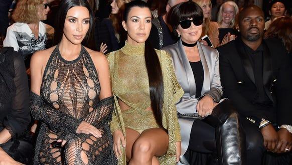 (Left to right:) Kim Kardashian, Kourtney Kardashian,