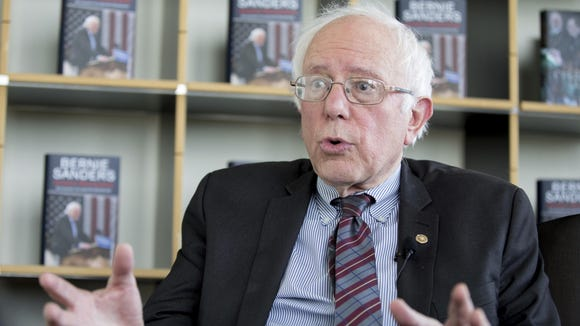 Sen. Bernie Sanders, I-Vt., speaks to journalists as