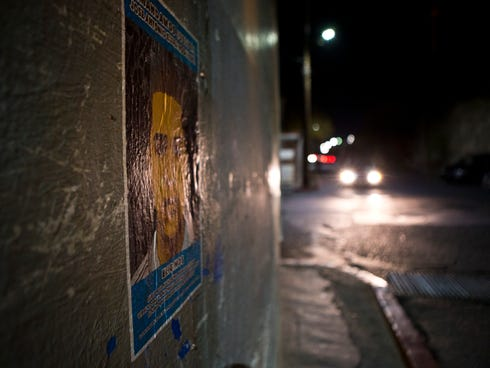 A poster on the emergency medical office building is seen in Nogales, Sonora, depicts 16-year-old Jose Antonio Elena Rodriguez, who died after being shot multiple times by one or more U.S. Border Patrol agents.