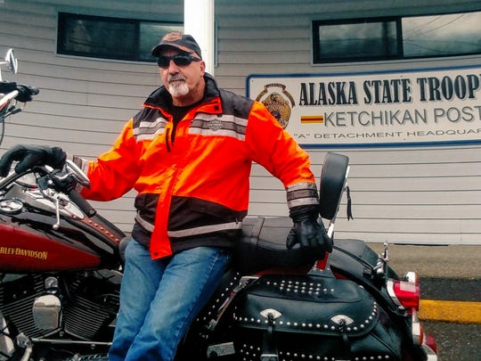 Jeff Dold outside an Alaska State Trooper post in Ketchikan, Alaska this summer. Alaska was the final state Dold needed to ride in to have ridden a motorcycle in all 50 states.