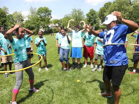 A dozen players for the NY Giants came to the Thomas Jefferson Middle School to participate in field day