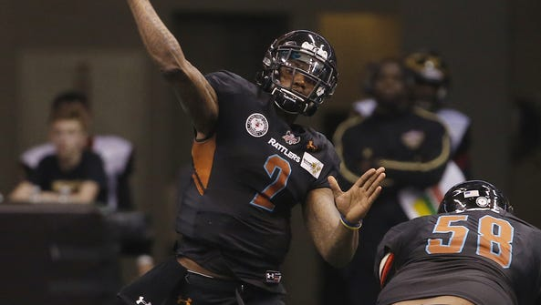 Rattlers' Darron Thomas (2) throws a pass against the