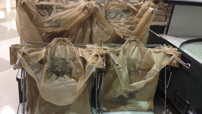 Bisbee is changing its ban on plastic grocery bags to avoid the possibility of losing state funding.
