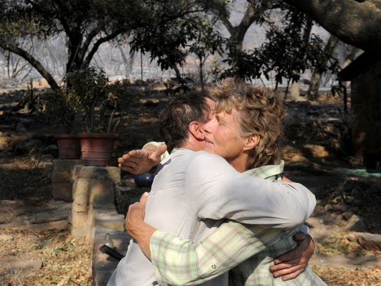 Sage Joyner hugs Karin Dron, who lives on Gridley Road