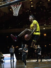 Terrance Ferguson competes in the slam dunk contest