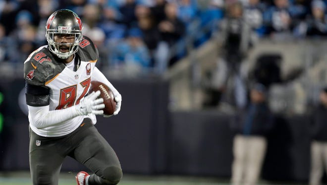 In this Jan, 3, 2016, file photo, Tampa Bay Buccaneers' Austin Seferian-Jenkins (87) runs all alone against the Carolina Panthers during the second half of an NFL football game in Charlotte, N.C. The New York Jets have claimed tight end  Seferian-Jenkins off waivers from the Buccaneers, who cut him last week after he was arrested on suspicion of driving while under the influence.