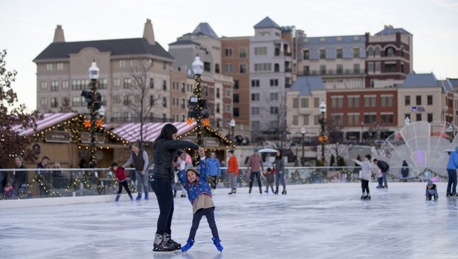 Ice skaters on an unseasonably warm afternoon at Carmel's Christkindlmarkt, Carmel, Wednesday, Nov. 29, 2017.
