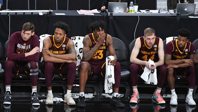 Mar 7, 2018; Las Vegas, NV, USA; Players on the Arizona Sun Devils bench watch as the final seconds tick off the clock of the first game of the Pac-12 Tournament against the Colorado Buffaloes at T-Mobile Arena. Mandatory Credit: Stephen R. Sylvanie-USA TODAY Sports
