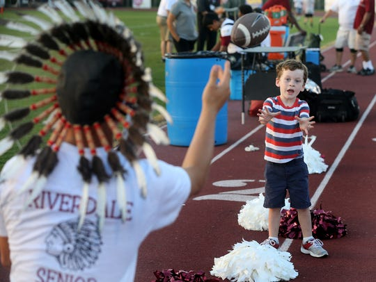 Asher Peyton, 3, plays a game of catch with the Riverdale