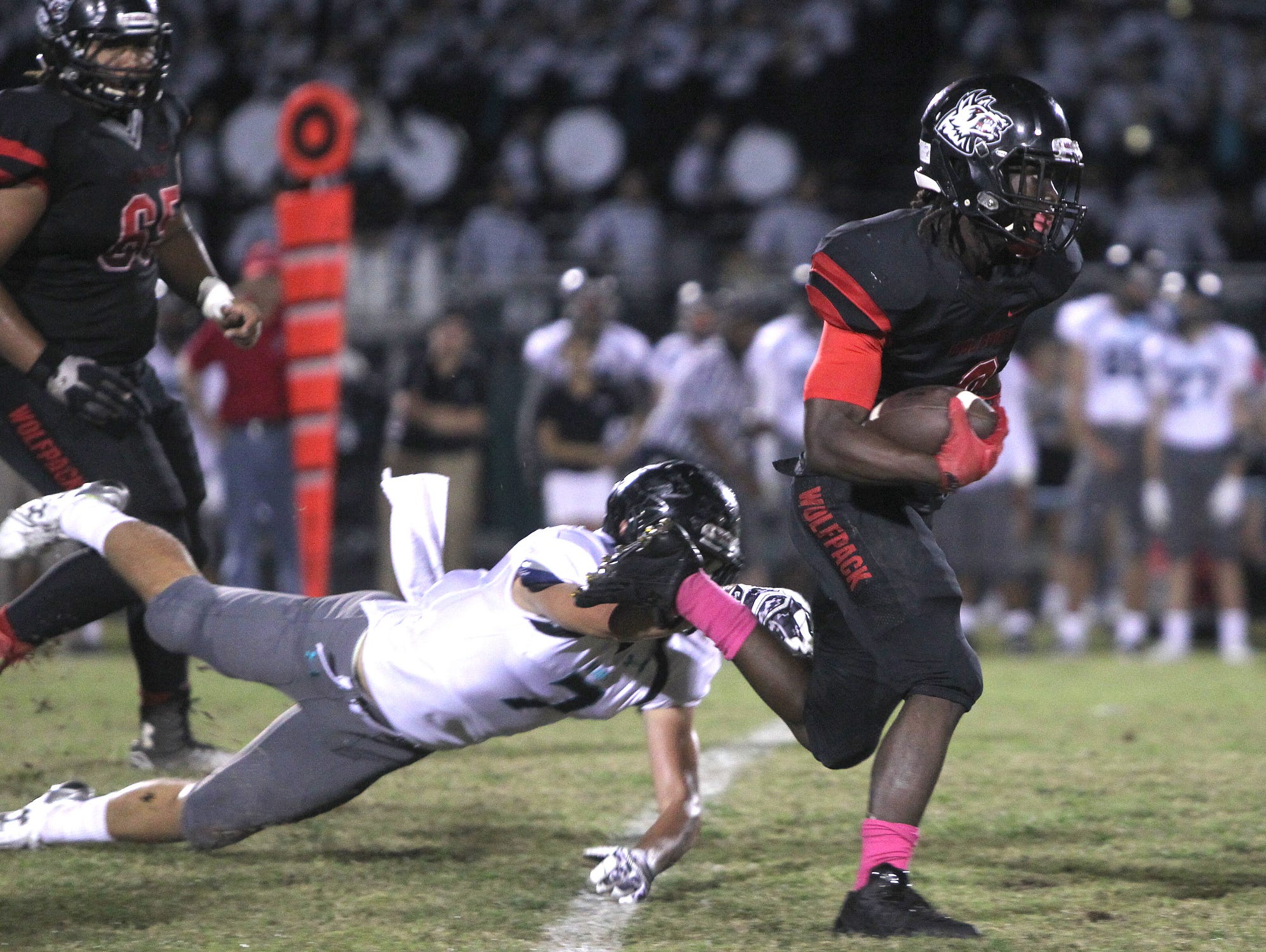 Gulf Coast defender Galvin Hoopes looses his grip on South ball carrier Willie Johnson at South Fort Myers High School Friday in Fort Myers.
