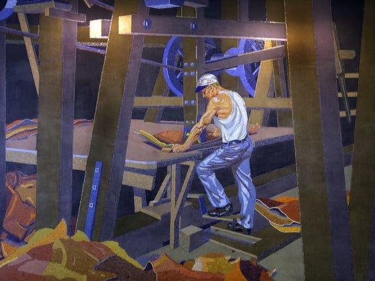 Artist Winold Reiss' mosaic mural of  worker John A.
