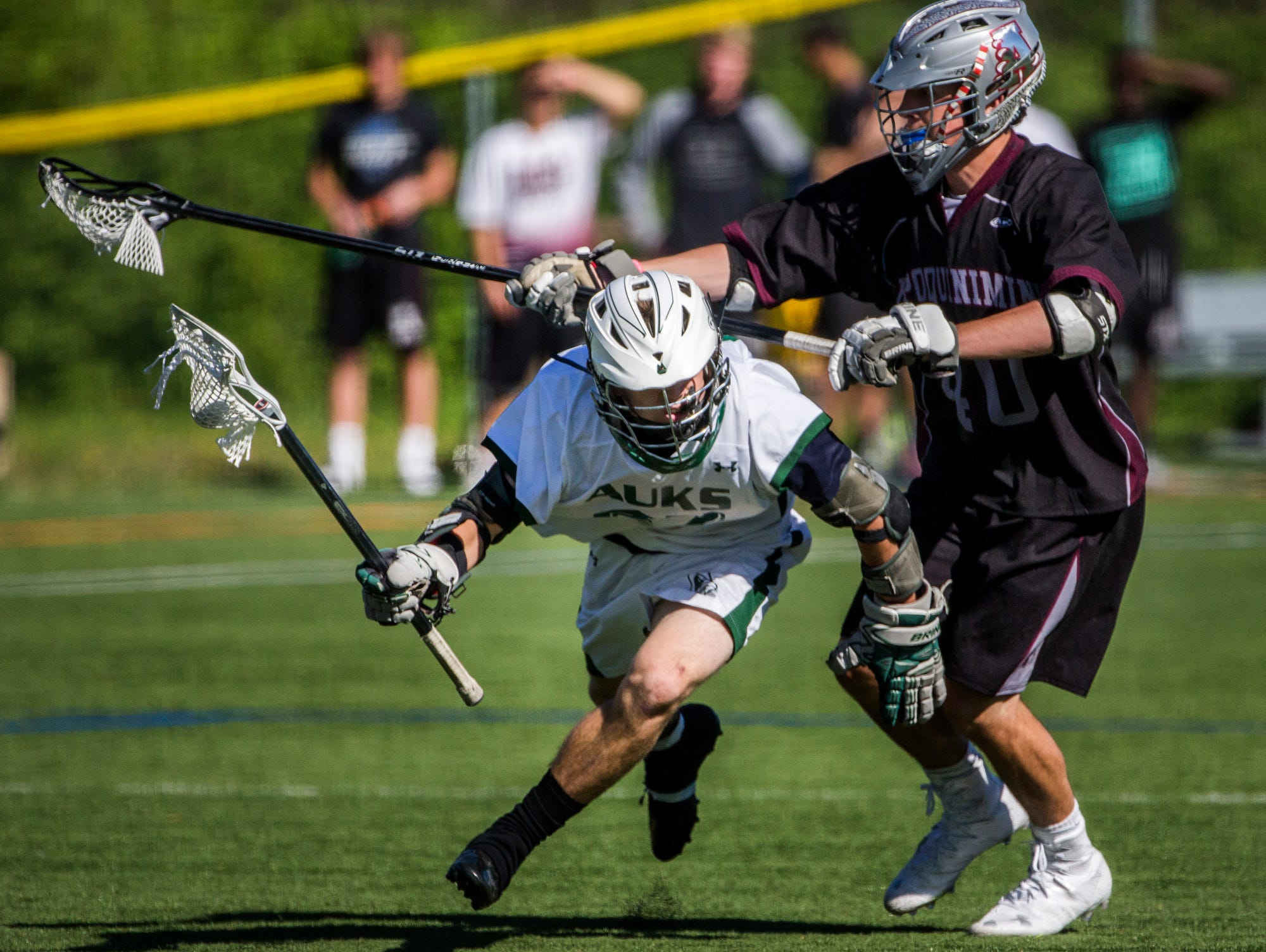 Archmere's Benjamin Revak ducks under the stick of Appoquinimink's Nicholas Bowen in the second quarter of Appoquinimink's 13-12 win over Archmere at Archmere Academy on Wednesday afternoon.