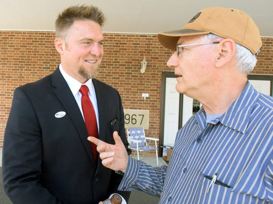 Jon Ritchie, left, jokes with voter Peter Hollander of Mechanicsburg outside the polls at Wesley United Methodist Church in Mechanicsburg Tuesday, April 26, 2016. Ritchie is a candidate in the race for the 31st Senate District. Bill Kalina photo