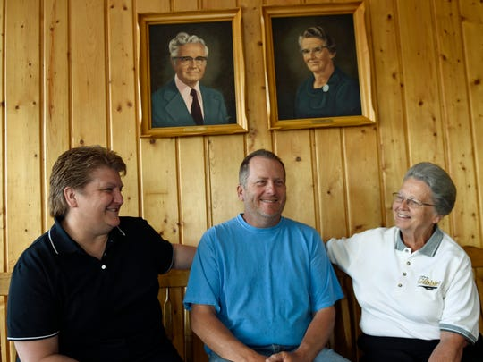 Kim and Rodney Eshleman are joined with Vernice Gibble-Eshleman chat under portraits of Gibble-Eshleman's parents Ray and Mary Gibble. The Greencastle area restaurant has been in business for 40 years.