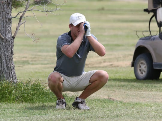 Dominic Haskins scopes out a fairway shot Sunday at the 71st Annual Anthony Invitational golf tournament.