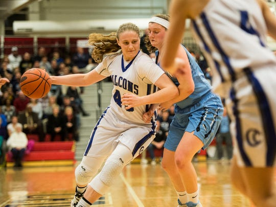 Cedar Crest's Alyssa Austin drives to the hoop against